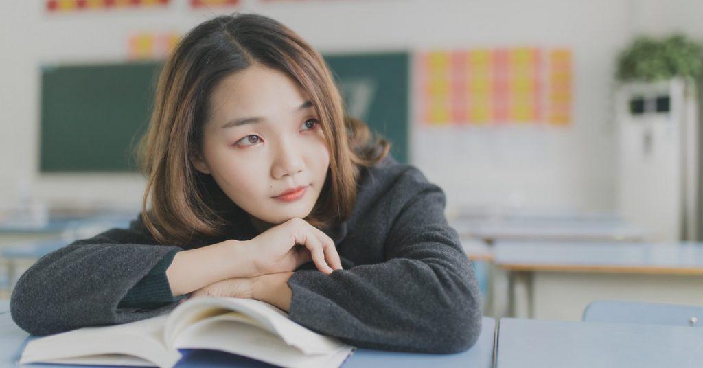 Girl bored reading