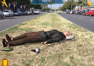 Albert Einstein lieing on grass
