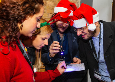 Players with Christmas hats trying to solve a puzzle
